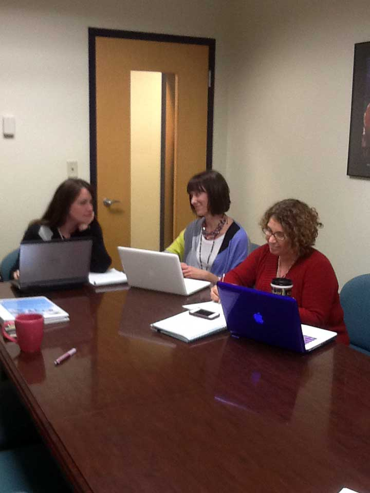Hampton core team in a planning meeting - Noel Woolard, Holly Whittenburg, and Kelly Siegel